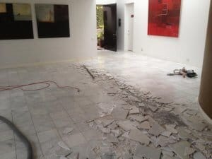 During the process, of tile removal, large vacuums are used to extract dust